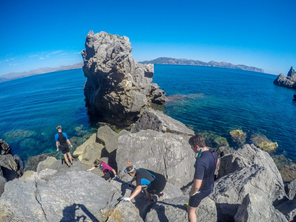Coasteering group rock scrambling at La Victoria, Mallorca