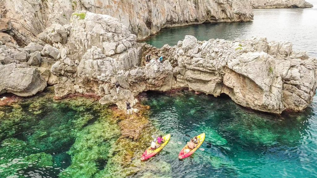 People kayaking and coasteering at la Victoria Mallorca